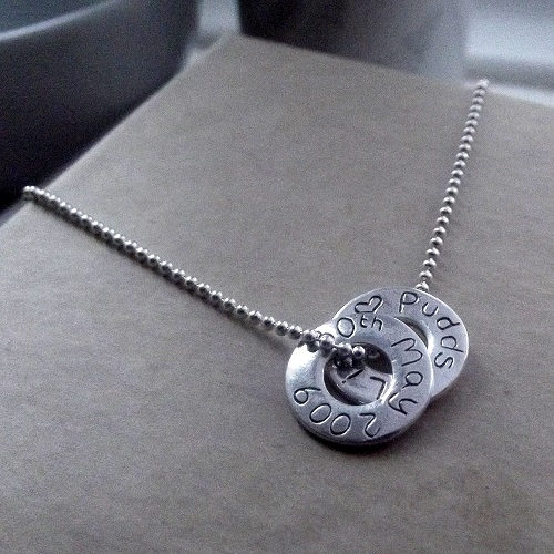 Image depicting Personalised Ring Necklace with two rings against grey background.