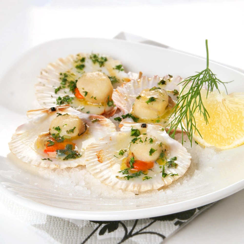 Party Foods. Image showing Queen Scallops on Shell on plate